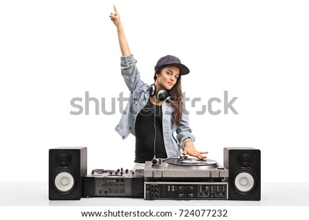 Female DJ playing music on a turntable isolated on white background Royalty-Free Stock Photo #724077232