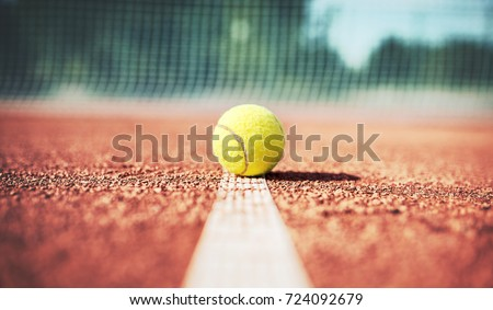 Tennis game. Tennis ball on the tennis court. Sport, recreation concept #724092679