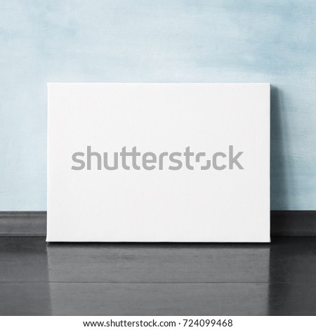 Mock-up poster in the interior. Blank horizontal canvas. Blue wall on background.