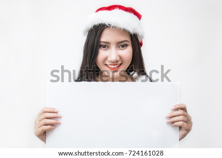 Portrait of asian beautiful woman wearing santa costume holding the paper. Christmas party and holiday background and banner concept, copyspace #724161028
