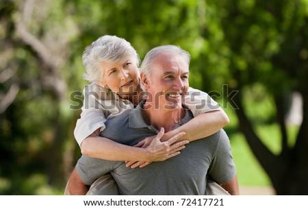 Man giving wife a piggyback #72417721