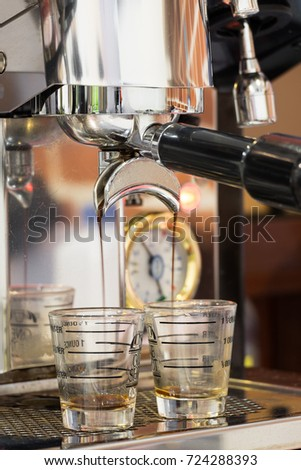 Double shot coffee pouring from Espresso machine. Perfect brewing. #724288393