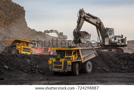 Loading of coal into truck. Excavator at work . Mining #724298887