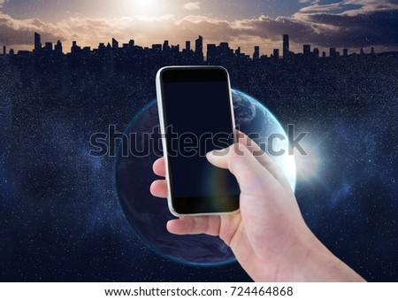 Digital composite of Hand holding phone with glow #724464868
