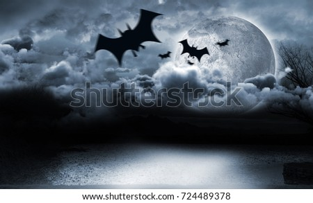 Digital image of silhouette bat against moon lighting the water  #724489378