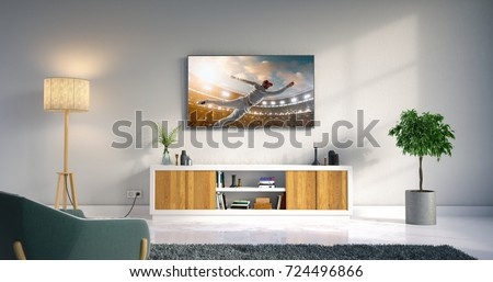3D illustration of a living room led tv on white wall with wooden table and plant in pot showing cricket game moment . #724496866