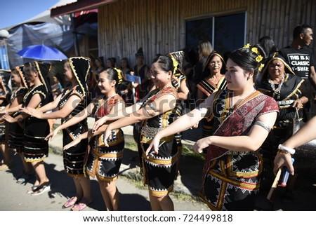 KOTA KINABALU, MALAYSIA - MAY 31, 2017: Group of people in their traditional costume during Sabah Harvest festival celebration in Kota Kinabalu, Sabah Borneo, Malaysia. #724499818