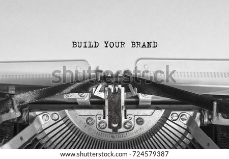 BUILD YOUR BRAND typed words on a vintage typewriter #724579387