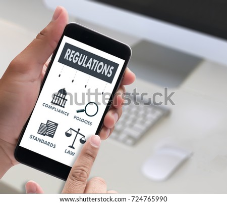 REGULATIONS and COMPLIANCE Rules Law professionals businessman working concept #724765990