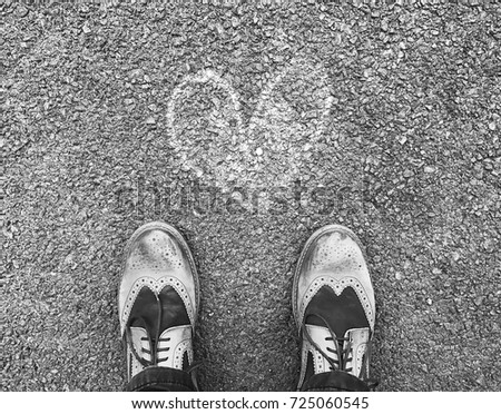 Shoes on the road with heart chalk sign. #725060545
