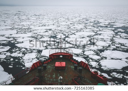 Icebreaker going through the ice fields, Arctic Royalty-Free Stock Photo #725163385