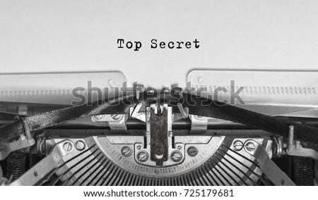 Top Secret typed words on a Vintage Typewriter #725179681