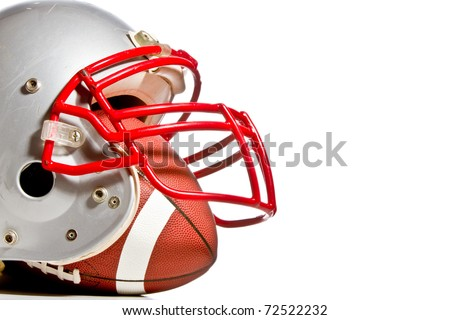 This is a shot of an old scratched up football helmet with a football inside of it. Shot with high contrast on and isolated white background. #72522232