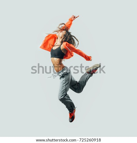 Athletic modern style dancer jumping, energy and fitness concept Royalty-Free Stock Photo #725260918