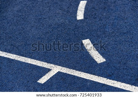 close up of a Blue sport field with white lines #725401933