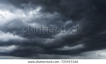 Before heavy rain storm. On the sky is covered all over by the clouds. A lot of lightning and strong wind. The dark clouds is look like  a big  black smoke from  erupting volcano #725415166