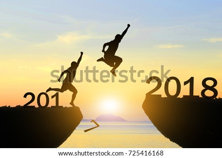 Men jump over silhouette Happy New Year 2018 #725416168