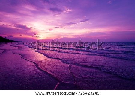 Nature in twilight period which including of sunrise over the sea and the nice beach. Summer beach with blue water and purple sky at the sunset.  Royalty-Free Stock Photo #725423245
