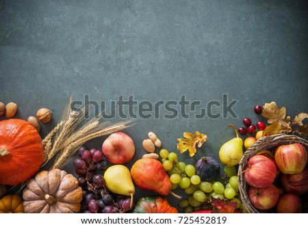 Autumn fruits and pumpkins with fallen leaves on rustic background. Top view Royalty-Free Stock Photo #725452819