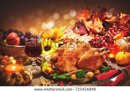 Roasted whole turkey on festive rustic table with autumn decoration for Thanksgiving Day #725456848