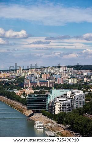 Slovakia, Bratislava, capital city at Danube River, cityscape with hillside houses, apartment buildings, blocks of flats. #725490910
