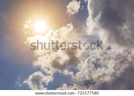 Beautiful cloudy sky with sunlight Royalty-Free Stock Photo #725577580