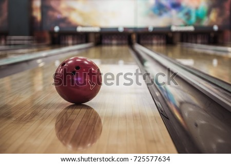 Modern bowling room waiting for visitors, balls on bowling alley