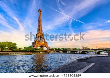 Paris Eiffel Tower and river Seine at sunset in Paris, France. Eiffel Tower is one of the most iconic landmarks of Paris. Postcard of Paris #725606359