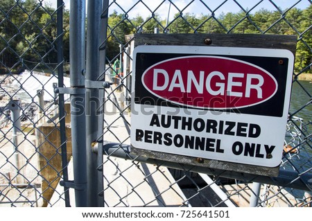 Danger - Authorized Personnel Only Sign In Front Of Dam Station #725641501