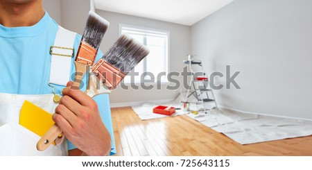 Painter hand with painting brush Royalty-Free Stock Photo #725643115