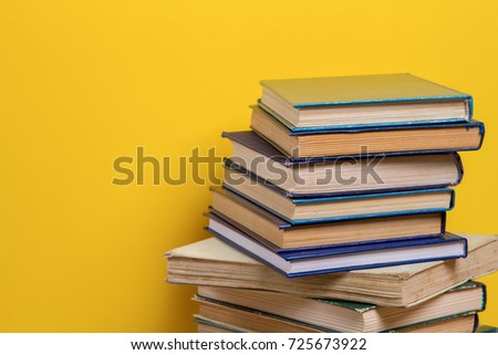 stack of Old books isolated on yellow #725673922