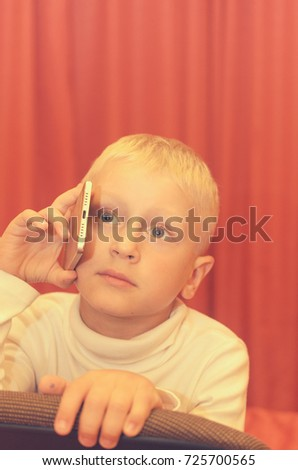 Little boy talking on the phone expressing his emotions #725700565