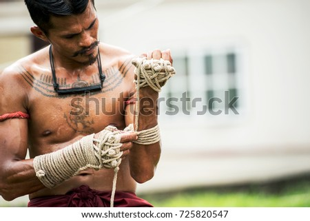 Muay Thai athlete training at Thai boxing indoors ultimate fight concept Royalty-Free Stock Photo #725820547