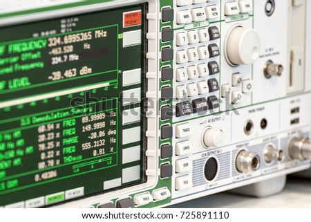 Fragment of a modern digital oscilloscope. Scientific measuring equipment. Abstract industrial background. #725891110