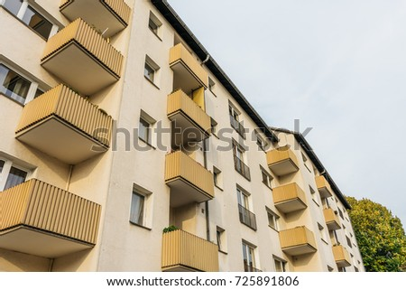 typical apartment house at berlin with yellow balcony #725891806