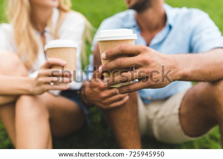 selective focus of man and woman with coffee to go in hands #725945950