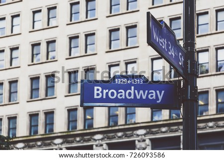NEW YORK, NY - September 3rd, 2017: Detail of Broadway and West 34th Street signs and building in the background #726093586