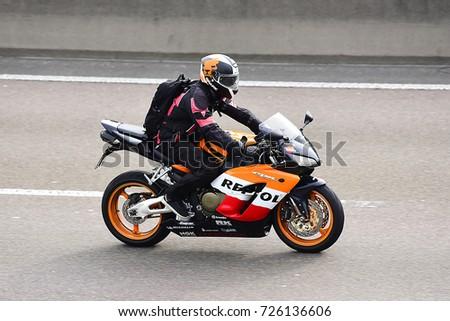 FRANKFURT,GERMANY-SEPT 30: unknown Rider on the freeway on September 30,2017 in Frankfurt,Germany. #726136606