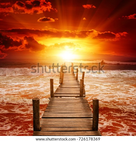 Wooden pier for boats in ocean on background epic sunset.   #726178369