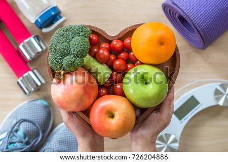 Healthy lifestyle concept, eating clean food good health dietary in heart dish with sporty aerobic body exercise workout training class gym equipment, weight scale and sports shoes in fitness center #726204886