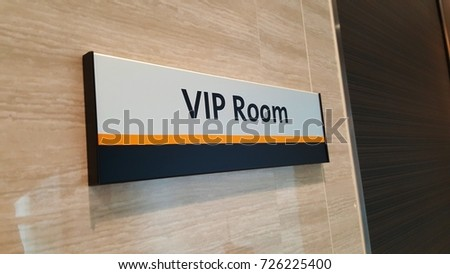 VIP room sign on wall in front of a room for special guests and important speaker at building office, Thailand. Business lounge concept. Angled view.