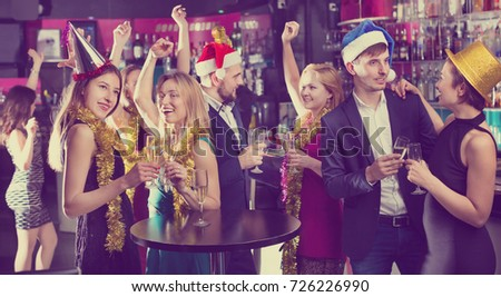Young cheerful friends dancing on a new year party with cocktails #726226990