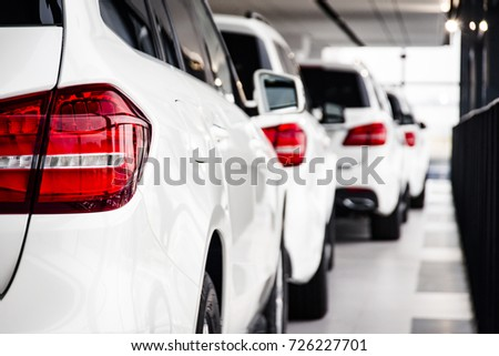 A row of new cars parked at a car dealer shop #726227701