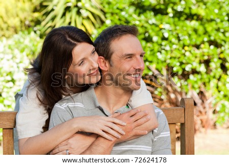 Glad couple hugging in the garden #72624178