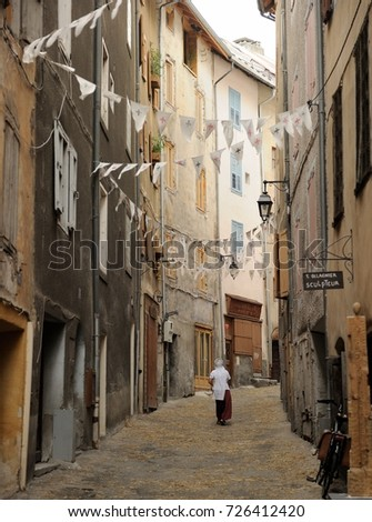 lady in an old road in Briancon, France, August 2015 #726412420