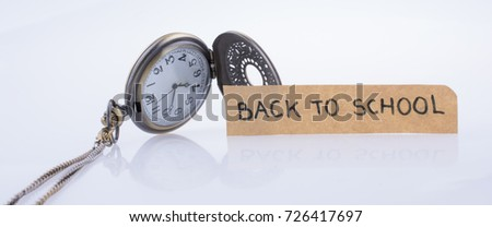Back to school written title and a pocket watch #726417697