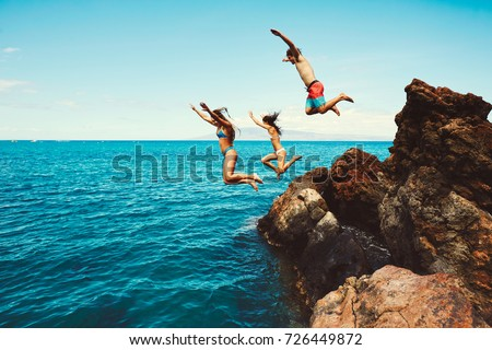Cliff jumping into the ocean, summer fun adventure lifestyle #726449872