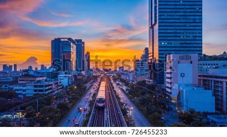 Sky train mass transit system in Bangkok City moving to alive in platform at sunset, Bangkok, Thailand. Royalty-Free Stock Photo #726455233