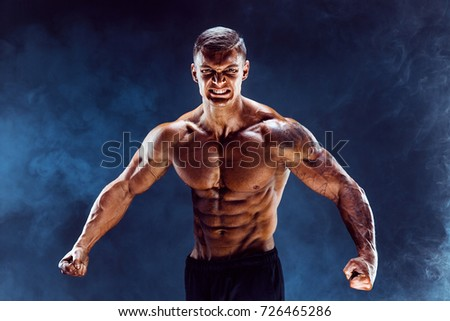 Very brawny guy bodybuilder posing. Beautiful sporty guy male power. Fitness muscled man. Roar. Smoke cold background.  #726465286
