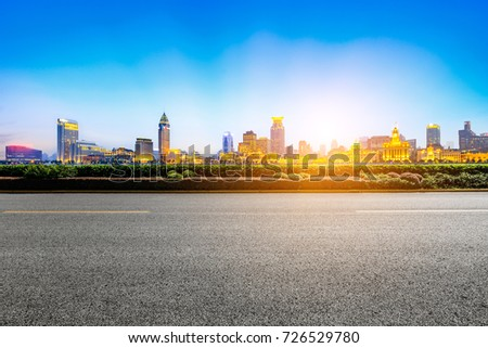 Asphalt road and modern cityscape in Shanghai at sunset #726529780